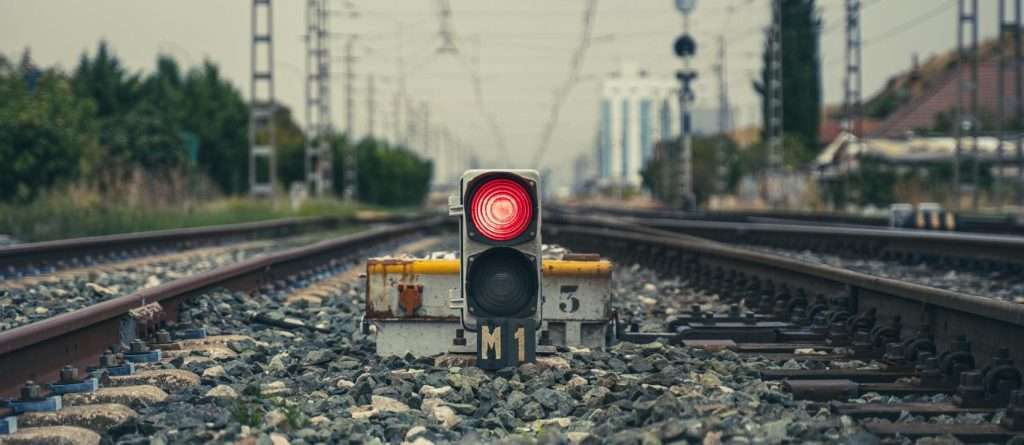 a red traffic light on a railway track