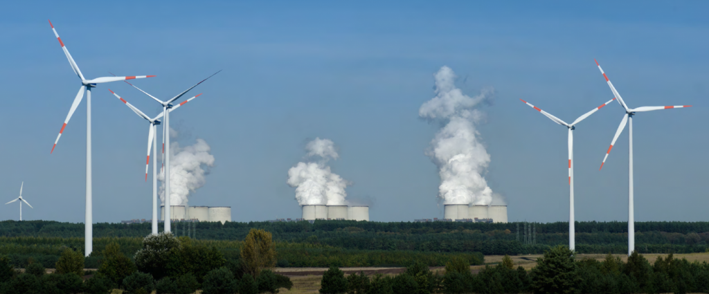Wind mills in front of a coal-fired power plant - Green development in Russia's coal regions